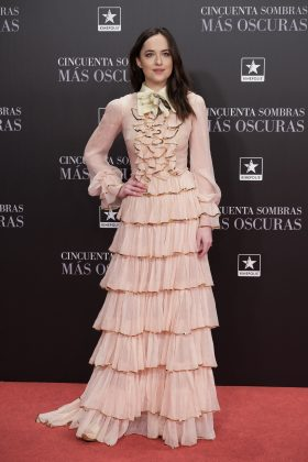 "Dakota went for retro glamour at the premiere of ""Fifty Shades Darke"" in Madrid wearing a Victorian-inspired ruffled pale pink Gucci gown. (Photo: WENN)"