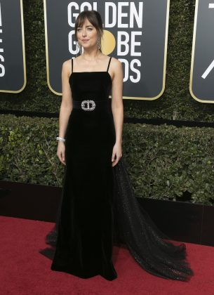 Dakota stuck to the 2018 Golden Globes all-black dress code and wore a velvet Gucci gown with an interesting glittery tulle trail and waist-cinching belt. (Photo: WENN)