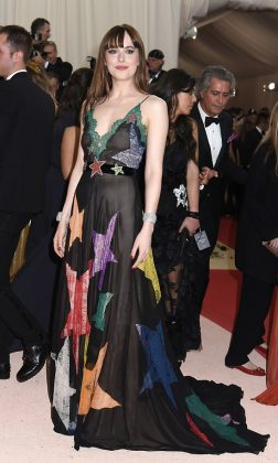 "Dakota Johnson was a cosmic vision at the 2016 ""Manus x Machina: Fashion in an Age of Technology"" Met Gala wearing a colorful gown with lace stars by Gucci. (Photo: WENN)"