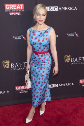 Clarke arrived at the 2018 BAFTA tea party wearing a gorgeous blue vintage dress that featured a floral pattern in red. (Photo: WENN)