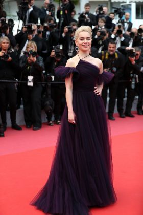 "Clarke wore a purple Dior tulle dress that left her shoulders bear with fringe sleeves at the Cannes premiere of ""Solo: A Star Wars Story"". (Photo: WENN)"