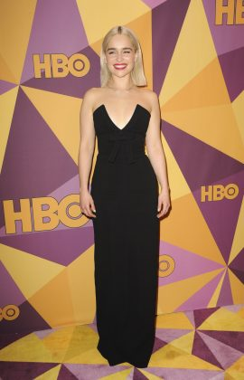 Emilia stuck to the all-black dress code for the 2018 Golden Globes wearing a simply Miu Miu column dress with a plunging neckline. (Photo: WENN)