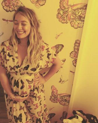 Hilary taking matchy matchy to a whole other level in this maternity butterfly-print boho dress. (Photo: Instagram)