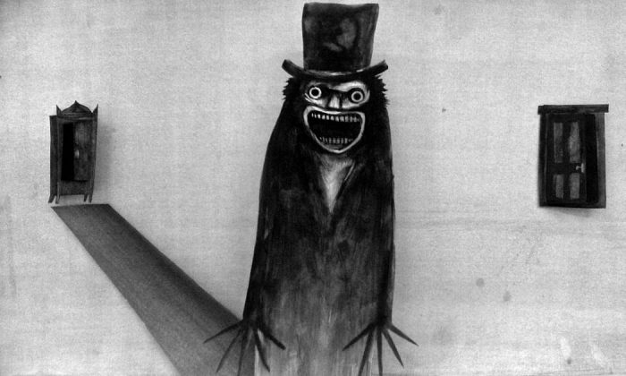 """The Babadook""— A widowed mother has to deal with her son's constant fear of monsters. After finding a children's book titled ""The Babadook"", she soon discovers that the disturbing character may be a sinister presence lurking around her home. (Photo: Release)"