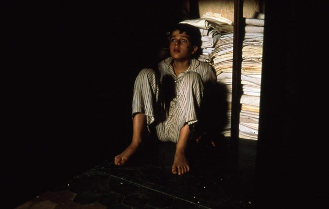 """The Devil's Backbone""—During the Spanish Civil War, Carlos is left behind by his family in an orphanage. He starts feeling the presence of a ghost and soon learns that he's the missing orphan Santi. After seeing Santi several time, Carlos one day learns the dark secret behind his disappearance. (Photo: Release)"