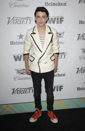 Noah amped up his other-wise casual look with a chic white tweed jacket with black distressed hem and orange Converse at the 2018 Variety and Women in Film Emmy Party. (Photo: WENN)
