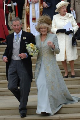 Camila Parker married Prince Charles wearing a pale-blue chiffon dress and gold-embroidered overcoat, accessorized with a feathered headpiece. (Photo: WENN)