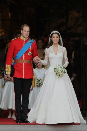Kate Middleton's Alexander McQueen is one of the most well-known wedding dresses in recent history. Th lace gown featured a 9-foot-long train. (Photo: WENN)