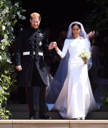 Megan Markle star in the wedding of the year wearing a minimal Givenchy wedding gown with open bateau neckline that gracefully framed her shoulders. (Photo: WENN)