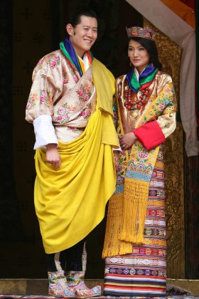 Jetsun Pema became a queen at age 21 when she married King of Bhutan in 2011. She wore a traditional, vibrant silk garment with yellow tasseled shawl. (Photo: WENN)