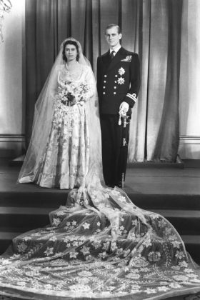 The then-princess Elizabeth wed Prince Philip in 1947. She wore a Norman Hartnell wedding dress, which featured long sleeves and a stunning veil. (Photo: WENN)