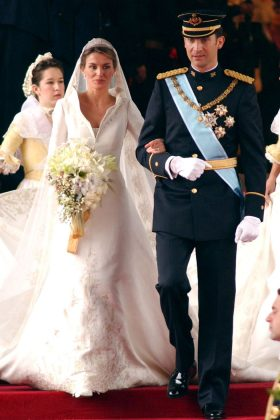 The now-queen Letizia of Spain married Felipe VI in 2004. The Spanish royal wore a dress by Manuel Pertegaz with a dramatic high collar and 14-foo train. (Photo: WENN)