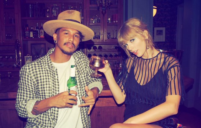 Taylor Swift and her one of her back-up dancers gave the camera a sultry look they raised a glass. (Photo: Instagram)