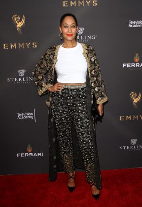 Tracee Ellis Ross celebrated her Emmy nomination at the 2017 cocktail reception wearing a simple white shirt paired with ornate coat and pants. (Photo: WENN)