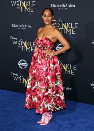 "Ross attended the world premiere of ""A Wrinkle In Time"" wearing a strapless pink floral Michael Kors dress paired with blushed colored satin boots. (Photo: WENN)"
