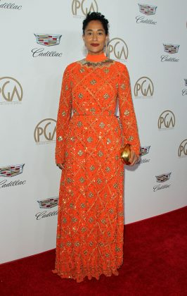 The actress walked down the red carpet at the 2018 Producers Guild Awards wearing a stunning coral dress by Tory Burch paired with gold accessories. (Photo: WENN)