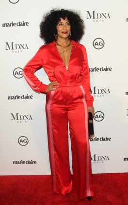 Tracee Ellis Ross attended the 2018 Marie Claire's Image Makers Awards sporting a plunging red, pink striped tracksuit by Valentino. (Photo: WENN)
