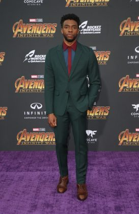 "The Marvel actor walked down the red carpet at the ""Infinity War"" premiere wearing a Prada green kid mohair suit with a denim blue and burgundy bicolor shirt. (Photo: WENN)"
