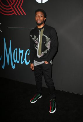 Chadwick cut a casual figure in a black and sweatshirt and strippy trainers at GQ's 2018 all star party. (Photo: WENN)