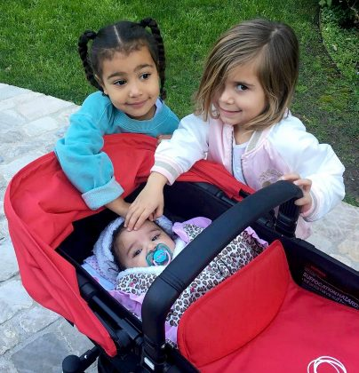 Mommies in training? Cousins North and Penelope were hand-on with their baby cousin during a walk with dad Rob. (Photo: Instagram)