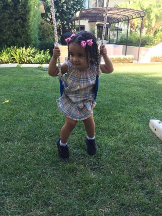 Dream looked extra cute a fancy hair-do and pink bows as she swung outdoors during a fun evening with dad. (Photo: Instagram)