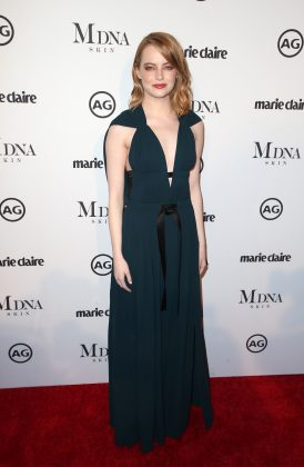 Stone turned heads at Marie Claire's Image Maker Awards 2018 wearing an emerald green dress and a bold orange smokey eye for the event. (Photo: WENN)