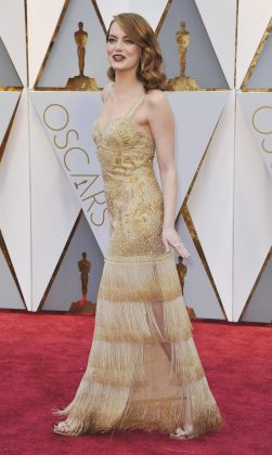 Emma twinned with her Oscar in a gold Swarovski crystal-embroidered gown by Givenchy at the 2017 Academy Awards. (Photo: WENN)