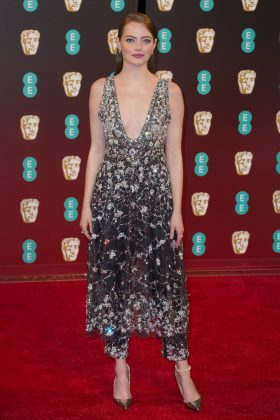 Emma Stone stunned in a plunging, glittering gown worn over matching straight-leg trousers by Channel at the 2017 BAFTA awards. (Photo: WENN)