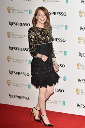 Emma turned head at the BAFTA Nominees' 2017 Party wearing a short gold and black ornate dress with large gems and feathers. (Photo: WENN)