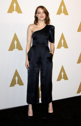 Emma attended the Oscar Nominees Luncheon 2017 wearing a satin navy-blue Stella McCartney cropped jumpsuit featuring a one-shoulder short sleeve. (Photo: WENN)