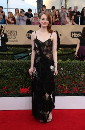 The actress stepped out for the SAG Awards in a black floral Alexander McQueen gown. (Photo: WENN)