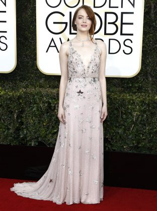 Emma dazzled in a nude Valentino gown covered with metallic silver star for the 74th Golden Globes Awards ceremony. (Photo: WENN)