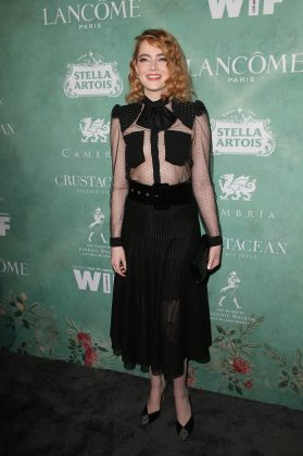 Emma attended the annual celebration of the 2018 Female Oscar Nominees wearing a Givenchy sheer tulle bow accented blouse grounded by a pleated skirt. (Photo: WENN)
