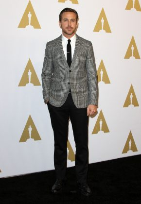 Ryan Gosling hit the red carpet while attending the 2017 Oscar Nominees Luncheon wearing a gray plaid blazer. (Photo: WENN)