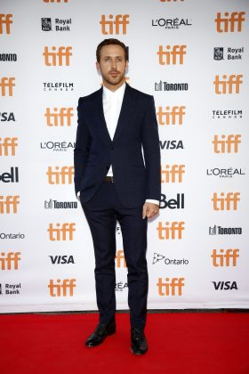"Ryan Gosling opted for a subtle squared navy suit and white button up for the TIFF premiere of ""La La Land."" (Photo: WENN)"