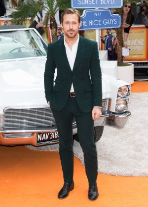 """Ryan looked effortlessly draper at the UK premiere of """"The Nice Guys"""" wearing a dark teal suit on top of a crisp white button up. (Photo: WENN)"""