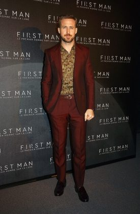 "Ryan was turned out in a forest green suit with a two-tone yellow polo shirt at the premiere of his movie ""First Man."" (Photo: WENN)"