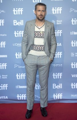 Ryan walked attended the 43rd TIFF wearing an interesting v-neck sweater with circular patterns light gray plaid suit. (Photo: WENN)