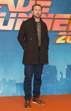 "Ryan took a fashion risk and paired a dark plaid coat with a knitted plaid sweater at the London photocall for ""Blade Runner 2049."" (Photo: WENN)"