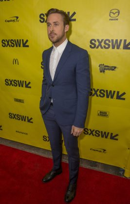"""Gosling opted for a simple look at the """"Son to Song"""" premiere, wearing a crisp white button up and grayish blue suit. (Photo: WENN)"""