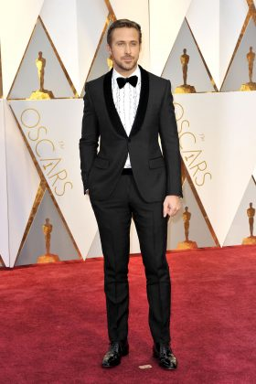 Ryan skipped the usual shirt 'n' suit combo in favor of a very interesting frilly button-up at the 2017 Oscars. (Photo: WENN)