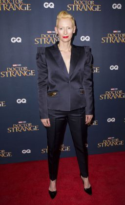 "Tilda Swinton dazzled in an 80's inspired navy pant suit with dramatic shoulder pads at the ""Doctor Strange"" screening in London. (Photo: WENN)"