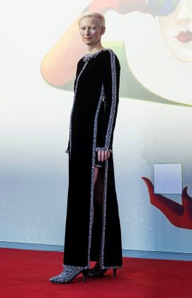 "Tilda dazzled at the premiere of ""L'Année dernière à Marienbad"" at the Venice Film Festival wearing a glamorous floor-length black embroidered velvet gown. (Photo: WENN)"