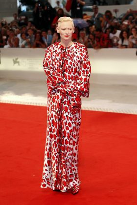 """Swinton turned heads at the """"At Eternity's Gate"""" premiere in a silk satin leopard-printed zipped dress by Schiaparelli with glove sleeves and matching show. (Photo: WENN)"""