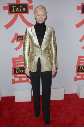 "Tilda rocked a gold Haider Ackermann blazer on top of a sleek all-black outfit for the star-studded New York premiere for ""Isle of Dogs."" (Photo: WENN)"