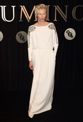 The actress looked radiant in a chic floor-length Grecian-inspired embroidered white dress at the 2018 BFI Luminous fund-raiser gala. (Photo: WENN)