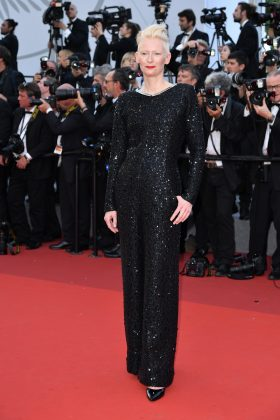 Tilda stepped at the Cannes Film Festival 70th anniversary event wearing a sparkling black sequin jumpsuit by Chanel. (Photo: WENN)