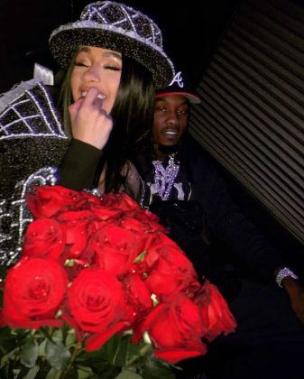 Offset posed with his bride as she cradled a massive bouquet of red roses. (Photo: Instagram)