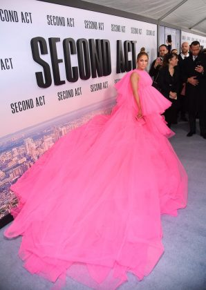 "Jennifer Lopez brought the drama to the premiere of her comedy ""Second Act"" in a hot pink tulle Giambattista Valli gown with huge train. (Photo: WENN)"