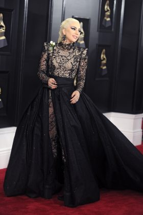 Lady Gaga won for most massive dress at the 2018 Grammys wearing an all-black Amani Privé lace ball gown equipped with the most over-the-top train. (Photo: WENN)